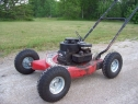 Can I Put Larger Wheels On My Lawn Mower? | Simplified Guide 2021